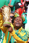 11 JUN 2010: South African fan with Jules Rimet trophy in the stands of the Soccer City Stadium holding a replica of the World Cup trophy, pregame. The South Africa National Team played the Mexico National Team at Soccer City Stadium in Johannesburg, South Africa in the opening match of the 2010 FIFA World Cup.