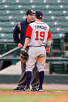June 3, 2009:  First Baseman Wes Timmons of the Gwinnett Braves argues a call with first base umpire Manuel Gonzalez during a game at Frontier Field in Rochester, NY.  The Gwinnett Braves are the International League Triple-A affiliate of the Atlanta Braves.  Photo by:  Mike Janes/Four Seam Images