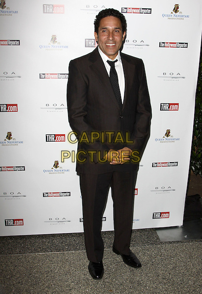OSCAR NUNEZ.The Hollywood Reporter's Philanthropist Of The Year Award Reception held At BOA Sunset, West Hollywood, California, USA..November 16th, 2009.full length black suit .CAP/ADM/KB.©Kevan Brooks/AdMedia/Capital Pictures.
