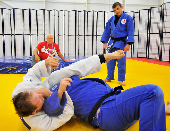 LONDON, ENGLAND – 08/26/2012:  Justin Karn, Tony Walby, Tim Rees and coach Tom Thomson of the Canadian Judo Team during a training session at the London 2012 Paralympic Games at Mayesbrook Park SportHouse. (Photo by Matthew Murnaghan/Canadian Paralympic Committee)