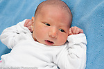 3 day old newborn baby boy lying on back, alert, closeup, skin tyical of newborn, blotchy, red