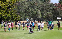 Spectators follow the lead group during the Charles Tour, Christies Mt Maunganui Open, Mt Maunganui Golf Club, Tauranga, New Zealand. Sunday 15 December 2019. Photo: Simon Watts/www.bwmedia.co.nz/NZGolf