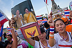 """Apr. 18, 2010 - Bangkok, Thailand: Pink Shirts hold up a photo of Thai King Bhumibol Adulyadej and his wife, Queen Sirikit, during a peace rally in Bangkok Sunday. Thousands of so called """"Pink Shirts"""" jammed the area around Victory Monument in Bangkok to show support the Thai Monarch, King Bhumibol Adulyadej, and against the Red Shirts, who are demonstrating just a few kilometres away in the Ratchaprasong area. The Pink Shirts claim to not support either of the other political factions who wear colors - the Red Shirts, who support deposed Prime Minister Thaksin Shinawatra and their opponents the Yellow Shirts, who are against Thaksin.   Photo By Jack Kurtz"""