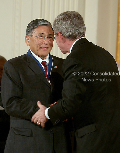 Washington, D.C. - December 15, 2006 -- Norman Y. Mineta receives the Presidential Medal of Freedom  from United States President George W. Bush and first lady Laura Bush during a ceremony in the East Room of the White House on Friday, December 15, 2006.  The medal is the nation's highest civil award.  It may be awarded &quot;to any person who has made an especially meritorious contribution to (1) the security or national interests of the United States, or, (2) world peace, or (3) cultural or other significant public or private endeavors&quot;.  Norman Mineta exemplifies the high ideals of service, integrity, and courage.  Despite the injustice of living in an internment camp when he was a child, he later served his country in the U.S. Army and went on to become a mayor, Congressman, and Cabinet Secretary under two Presidents.  The longest-serving Secretary of Transportation, he worked to improve the security of our transportation system and restore our confidence in air travel after the terrorist attacks of September 11, 2001.  The United States honors Norman Y. Mineta for a life of selfless and distinguished service to our Nation.<br /> Credit: Ron Sachs / CNP