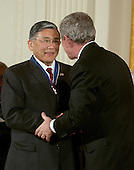 "Washington, D.C. - December 15, 2006 -- Norman Y. Mineta receives the Presidential Medal of Freedom  from United States President George W. Bush and first lady Laura Bush during a ceremony in the East Room of the White House on Friday, December 15, 2006.  The medal is the nation's highest civil award.  It may be awarded ""to any person who has made an especially meritorious contribution to (1) the security or national interests of the United States, or, (2) world peace, or (3) cultural or other significant public or private endeavors"".  Norman Mineta exemplifies the high ideals of service, integrity, and courage.  Despite the injustice of living in an internment camp when he was a child, he later served his country in the U.S. Army and went on to become a mayor, Congressman, and Cabinet Secretary under two Presidents.  The longest-serving Secretary of Transportation, he worked to improve the security of our transportation system and restore our confidence in air travel after the terrorist attacks of September 11, 2001.  The United States honors Norman Y. Mineta for a life of selfless and distinguished service to our Nation.<br /> Credit: Ron Sachs / CNP"