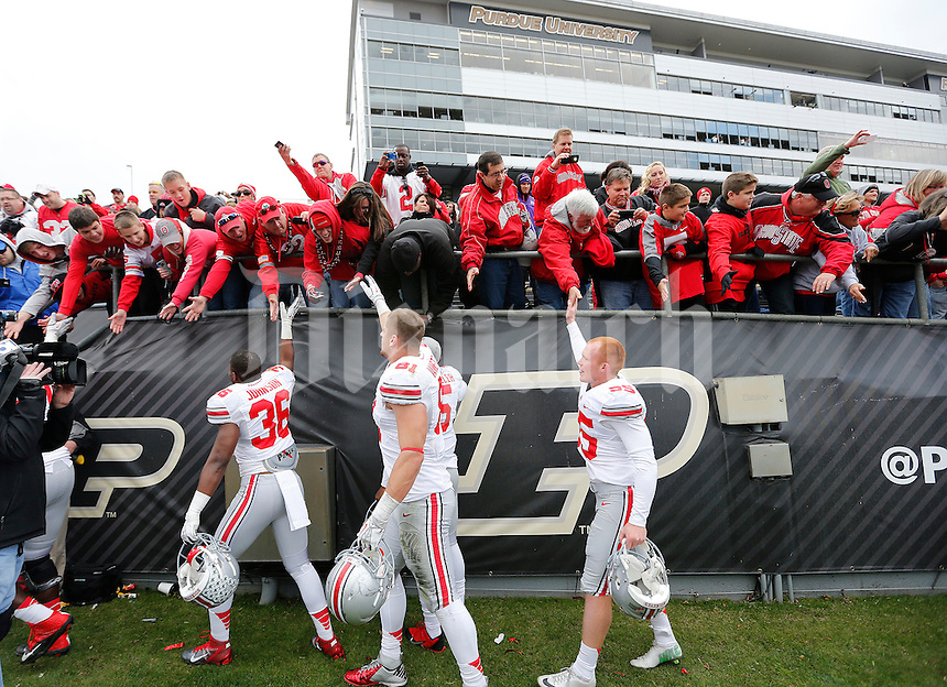 Ohio State players high five fans as they leave the field following the team's 56-0 win over Purdue during the NCAA football game at Ross-Ade Stadium in West Lafayette, Ind. on Nov. 2, 2013. (Adam Cairns / The Columbus Dispatch)