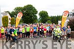 Dan Paddy Andy Festival: Tommy Quille, Limerick & Lyrecrompane , letft of picture  raises the flag at the start of the 5K & 10K walk/Run in aid of Enable Ireland at the Dan Paddy Andy festival in Lyrecrompane on Sunday morning last.