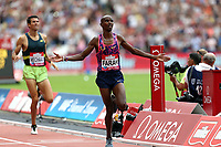 Mo Farah of Great Britain bears Sam Mcentee of Australia in the menís 3000 metres during the Muller Anniversary Games at The London Stadium on 9th July 2017
