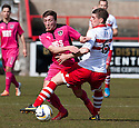 Airdrie's Scott Gray tries to get past Stirling's Ross Forsyth.