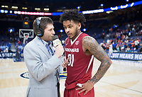NWA Democrat-Gazette/CHARLIE KAIJO Arkansas Razorbacks guard Anton Beard (31) interviews after the Southeastern Conference Men's Basketball Tournament quarterfinals, Friday, March 9, 2018 at Scottrade Center in St. Louis, Mo.
