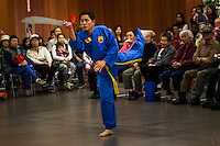 A martial arts performer with a traditional sword during the Lunar New Year event in San Leandro.