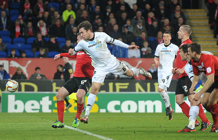 Derby's Richard Keogh heads towards goal ..Football - npower Football League Championship - Cardiff City v Derby County - Tuesday 05th March 2013 - Cardiff City Stadium - Cardiff..© CameraSport - 43 Linden Ave. Countesthorpe. Leicester. England. LE8 5PG - Tel: +44 (0) 116 277 4147 - admin@camerasport.com - www.camerasport.com
