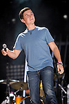 Scotty McCreery performs at LP Field during the 2011 CMA Music Festival on June 11, 2011 in Nashville, Tennessee.  Scotty performed on stage with Josh Turner.