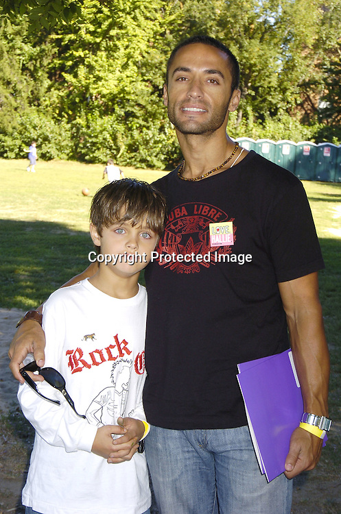 Kamar de los Reyes and son Caylen ..at Halliestock 2 benefit on September 24, 2005 at ..Sunnyside Gardens Park in Queens. This benefit raised money for Love, Hallie. ..Photo by Robin Platzer, Twin Images