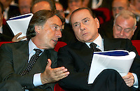 L'ex presidente di Confindustria Luca Cordero di Montezemolo parla al Presidente del Consiglio Silvio Berlusconi, destra, durante l'assemblea generale dell'organizzazione a Roma, 22 maggio 2008..Former President of the italian Confindustria enterpreneurs association Luca Cordero di Montezemolo speaks to the Italian Premier Silvio Berlusconi, right, during the general assembly in Rome, 22 may 2008..UPDATE IMAGES PRESS/Riccardo De Luca