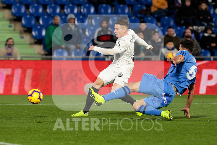 Getafe CF's Leandro Cabrera and Valencia CF's Kevin Gameiro during La Liga match between Getafe CF and Valencia CF at Coliseum Alfonso Perez in Getafe, Spain. November 10, 2018.