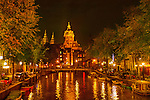 Church and canal in Amsterdam at night, Holland. .  John offers private photo tours in Denver, Boulder and throughout Colorado, USA.  Year-round. .  John offers private photo tours in Denver, Boulder and throughout Colorado. Year-round.