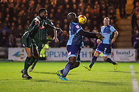 Adebayo Akinfenwa of Wycombe Wanderers controls the ball under pressure from Yann Songo'o of Plymouth Argyle during the Sky Bet League 2 match between Plymouth Argyle and Wycombe Wanderers at Home Park, Plymouth, England on 26 December 2016. Photo by Mark  Hawkins / PRiME Media Images.