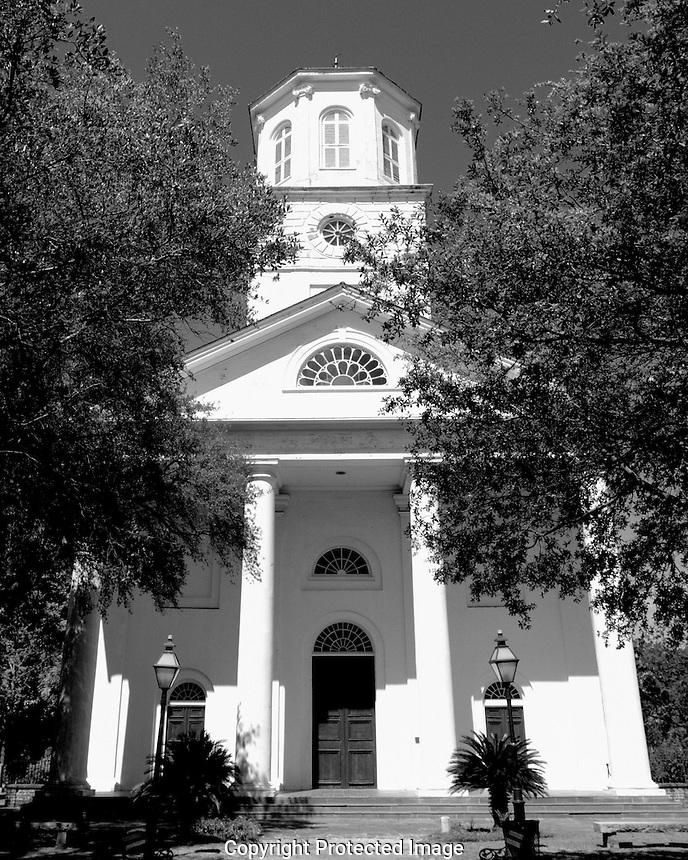 Soon after the founding of Charleston, the community of Presbyterians, dissenters to the Church of England, worshiped together in the White Meeting House, a wooden edifice on Meeting Street. The congregation included English, Irish, Scottish, French Huguenots, and Independent Presbyterians. In 1731, twelve families withdrew from the White Meeting House and established what is now the First (Scots) Presbyterian Church, modeled strictly on the Church of Scotland. This church grew rapidly. By the end of the century the building was inadequate to accommodate the worshippers and the necessity of a second Presbyterian church was realized. In 1809, fifteen men met and began planning for Second Presbyterian Church. The Reverend Andrew Flinn was called to organize the congregation. The church was built at the then substantial cost of $100,000, and on April 3, 1811, was dedicated with the corporate name of &quot;The Second Presbyterian Church of Charleston and Its Suburbs.&quot; Property for the church was obtained from the Wragg family, whose name was given to the area still known as Wraggborough. The impressive deed and documents of transfer of the property are displayed in the church narthex.<br />