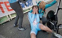 immediatly after finishing Tom Wirtgen (LUX) almost passes out and needs help getting off his bike<br /> <br /> Men Under-23 Individual Time Trial<br /> <br /> UCI 2017 Road World Championships - Bergen/Norway