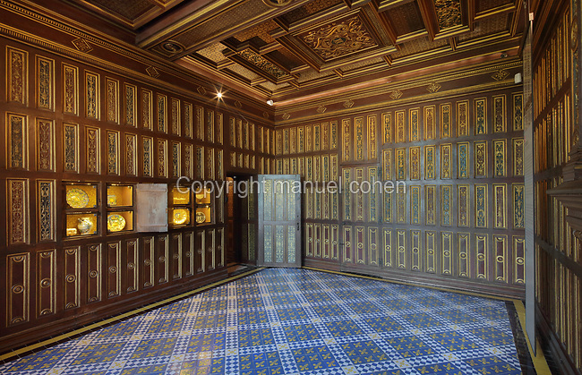 Studiolo, decorated with 180 carved, painted and gilded oak panels, under Francois I before 1520 in Italian Renaissance style, on the first floor of the Francois I wing, built early 16th century in Italian Renaissance style, at the Chateau Royal de Blois, built 13th - 17th century in Blois in the Loire Valley, Loir-et-Cher, Centre, France. The room was dedicated to reading, poetry, meditation and study. There are 4 secret compartments hidden in the panelling to conceal works of art, in the tradition of a cabinet of curiosities. The chateau has 564 rooms and 75 staircases and is listed as a historic monument and UNESCO World Heritage Site. Picture by Manuel Cohen