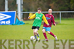 Spa Road's John Quirke gets his tackle in against Camp United's Ger Farrelly at Mounthawk park, Tralee on Sunday.