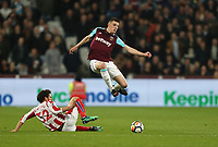 Stoke City's Ramadan Sobhi challenges West Ham United's Declan Rice<br /> <br /> Photographer Rob Newell/CameraSport<br /> <br /> The Premier League - West Ham United v Stoke City - Monday 16th April 2018 - London Stadium - London<br /> <br /> World Copyright &copy; 2018 CameraSport. All rights reserved. 43 Linden Ave. Countesthorpe. Leicester. England. LE8 5PG - Tel: +44 (0) 116 277 4147 - admin@camerasport.com - www.camerasport.com