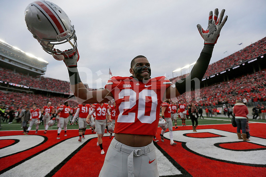 Ohio State Buckeyes defensive back Ron Tanner (20) celebrates the victory following the NCAA football game against Michigan at Ohio Stadium on Saturday, November 29, 2014. (Columbus Dispatch photo by Jonathan Quilter)