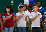 Children  sing a patriotic song during a Veterans Day ceremony at  Ashkar Elementary School.