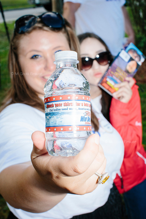 A campaign volunteer shows a Carson-themed water bottle before the arrival of Republican presidential candidate Dr. Ben Carson at Londonderry Old Home Day in Londonderry, New Hampshire.