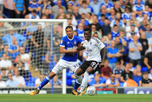 26th August 2017, Portman Road, Ipswich, England; EFL Championship football, Ipswich versus Fulham; Sheyi Ojo of Fulham holds off Myles Kenlock of Ipswich Town