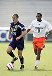 Duke's Danny Kramer (24) is chased by Virginia Tech's Scott Spangler on Wednesday, November 9th, 2005 at SAS Stadium in Cary, North Carolina. The Duke University Blue Devils defeated the Virginia Tech Hokies 2-0 during their Atlantic Coast Conference Tournament Quarterfinal game.