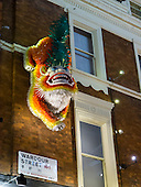 China Town, London, England. Chinese New Year dragon on the wall in Wardour street, Soho.