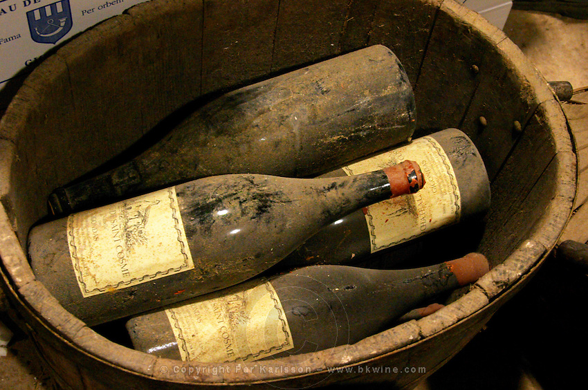 Magnum bottles in a small wooden vat at Chateau Saint Cosme, Gigondas, Vaucluse, Rhone, Provence, France