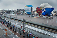 as the peloton passes through the city of Sint-Niklaas they are greeted by some hot air-balloons. <br /> <br /> 102nd Ronde van Vlaanderen 2018 (1.UWT)<br /> Antwerpen - Oudenaarde (BEL): 265km