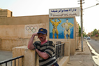 Baghdad, Iraq, May 20, 2003.Street scene at dusk: Hamid in front of his sports training club.
