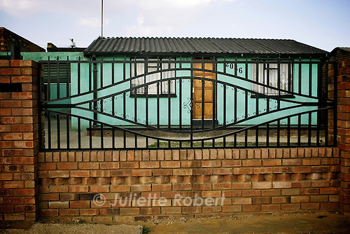 """A """"matchbox"""" house in a street in Soweto. April 2009"""