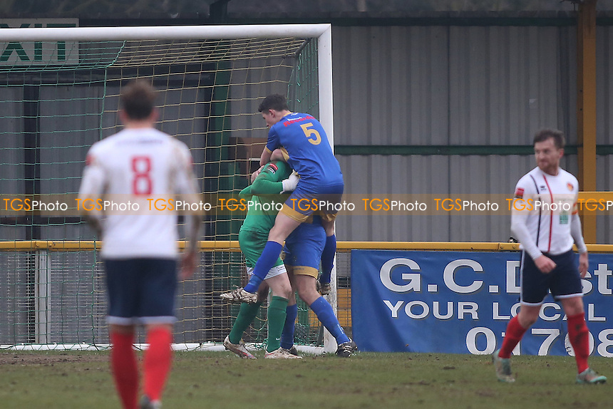 Callum Chafer of Romford  saves a penalty  and is mobbed  during Romford vs Witham Town, Ryman League Division 1 North Football at Ship Lane on 11th February 2017
