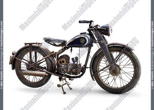Puch 125 old World War II period motorcycle 1947 year in a bad rusty and partly disassembled condition with open unique doppelkolben engine which has two parallel pistons Isolated silhouette on white background with a clipping path