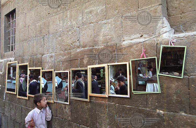 Mirrors on sale in the Old City of Sana'a reflect the bustle of one of the most ancient towns in the Arab world, established on an important trading route over two thousand years ago.