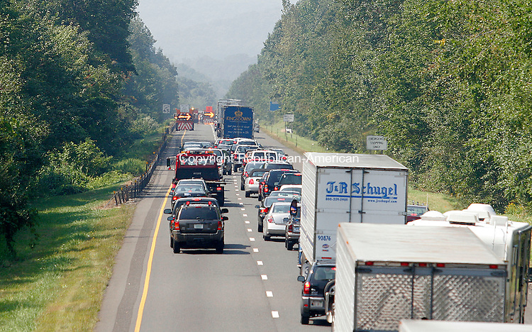 SOUTHBURY, CT - 09 SEPTEMBER 2006 - 090906JW02.jpg -- Traffic attemps to merge into the breakdown lane after an accident involving a tractor trailer and Connecticut State Police car closed the two lanes of I84 westbound between exits 16 and 15 Saturday. Jonathan Wilcox Republican-American