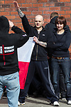 © Joel Goodman - 07973 332324 . 02/04/2011 . Blackburn , UK . A man extends his arm in a Nazi salute and poses for photographs . The English Defence League ( EDL ) hold a demonstration in Blackburn . Photo credit : Joel Goodman