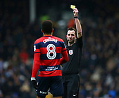 17th March 2018, Craven Cottage, London, England; EFL Championship football, Fulham versus Queens Park Rangers; Referee Chris Kavanagh gives a yellow card to Jordan Cousins of Queens Park Rangers after fouling Floyd Ayite of Fulham