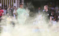 York City's Ryan Whitley waits for a flare to be taken off the pitch<br /> <br /> Photographer Alex Dodd/CameraSport<br /> <br /> Football Pre-Season Friendly - York City v Leeds United - Wednesday 10th July 2019 - Bootham Crescent - York<br /> <br /> World Copyright © 2019 CameraSport. All rights reserved. 43 Linden Ave. Countesthorpe. Leicester. England. LE8 5PG - Tel: +44 (0) 116 277 4147 - admin@camerasport.com - www.camerasport.com