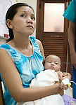 4 month old Kemo Izu waith with his mother before surgery to try to repair cataracts in both eyes at Angkor Children's Hospital in Siem Reap, Cambodia.