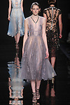 """Model walks runway in a lavender point d'esprit dress with lace underlay and embroidered detail from the Reem Acra Fall 2016 """"The Secret World of The Femme Fatale"""" collection, at NYFW: The Shows Fall 2016, during New York Fashion Week Fall 2016."""