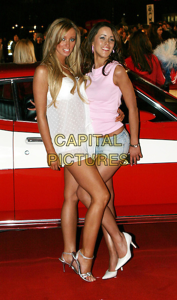 LAUREN POPE & NIKKALA.Starsky & Hutch UK premiere in Odeon Leicester Square.11 March 2004.Hope, page three girls, full length, full-length, white minidress, silver strappy sandals, shoes, heels, stilettos.www.capitalpictures.com.sales@capitalpictures.com.© Capital Pictures.