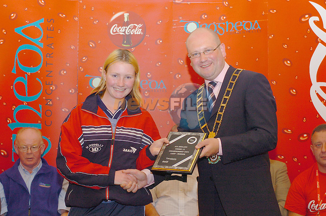 Ciara Crawley Stamullen CC receiving her plaque for U/13 Lady Winner from mayor of Drogheda Ged Nash in the Drogheda Wheelers/Drogheda Concentrates 2004 All Ireland Youth Championships U/13 final in Drogheda...Photo Fran Caffrey Newsfile.ie..This Picture has been sent to you by Newsfile Ltd..The Studio,.Millmount Abbey,.Drogheda,.Co. Meath,.Ireland..Tel: +353(0)41-9871240.Fax: +353(0)41-9871260.ISDN: +353(0)41-9871010.www.newsfile.ie..general email: pictures@newsfile.ie