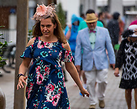 LOUISVILLE, KY - MAY 03: A woman searches for cover from the rain during Thurby at Churchill Downs on May 3, 2018 in Louisville, Kentucky. (Photo by Scott Serio/Eclipse Sportswire/Getty Images)