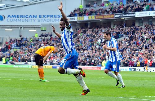 04.05.2013 Brighton, England. Brighton's Kazenga LuaLua celebrates as he scores during the Championship game between Brighton & Hove Albion and Wolverhampton Wanderers from the Falmer  Amex Stadium.